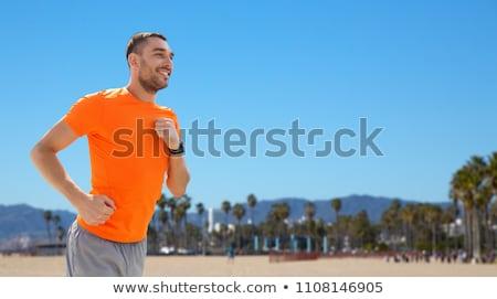 Boldog fiatalember fut Velence tengerpart fitnessz Stock fotó © dolgachov