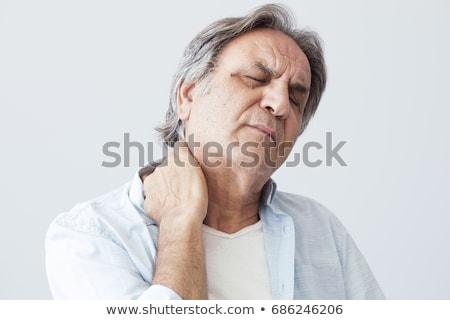 Człowiek cierpienie ból szyi posiedzenia sofa Zdjęcia stock © AndreyPopov