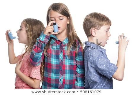 three childs using inhaler for asthma white background stock photo © lopolo