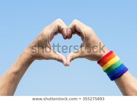 hand with gay pride rainbow flag and wristband Stock photo © dolgachov