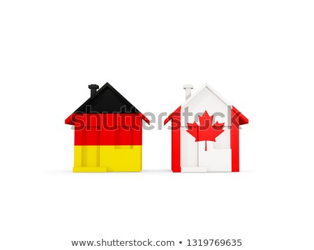 two houses with flags of germany and canada stock photo © mikhailmishchenko