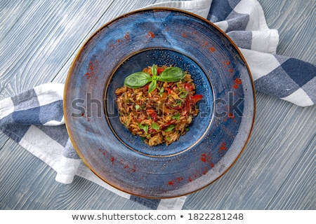 Delicious seafood risotto and greek salad Photo stock © karandaev