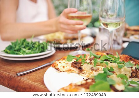 pizza and white wine in outdoor restaurant stock photo © dashapetrenko