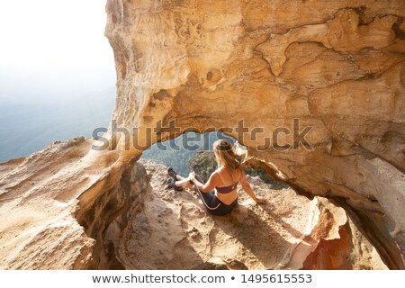 Female adventurer takes in cliff top cave views Blue Mountains Stock photo © lovleah