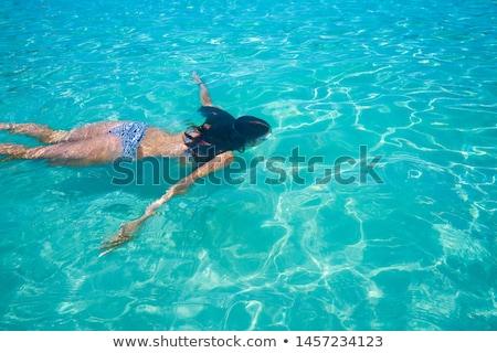 ibiza bikini girl swimming clear water beach stock photo © lunamarina