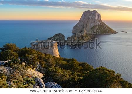 Es Vedra islet sunset in Balearic Islands Stock photo © lunamarina