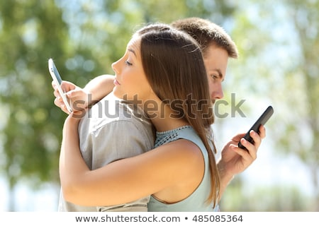 Woman Send Secret Messages by Smartphone Stock photo © robuart