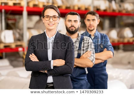 Three confident cross-armed workers of large modern chemical processing factory Stock photo © pressmaster