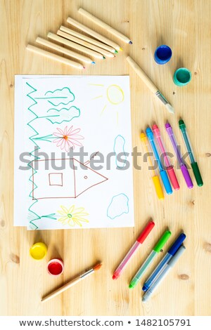 High angle view of drawing, paints, paintbrushes, crayons and highlighters Stock photo © pressmaster