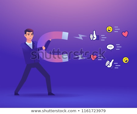 A man attracts people with a big magnet. stock photo © sgursozlu