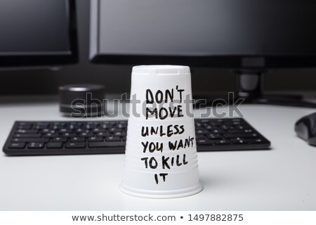 Message On Disposable Glass Over Desk Stock photo © AndreyPopov