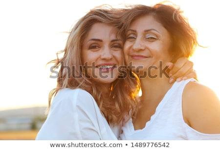 средний возраст женщину взрослый дочь закат Сток-фото © dashapetrenko