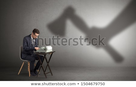 shadow threatening hard worker man stock photo © ra2studio