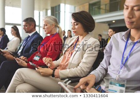 Side view of diverse business people with tablets attending a business seminar in office building Stock photo © wavebreak_media
