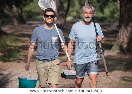 Amigos pesca neto caminando aire libre ocio Foto stock © dolgachov