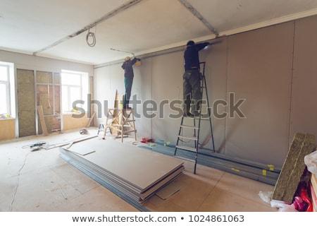 Worker building plasterboard wall. Stock photo © antonio_gravante