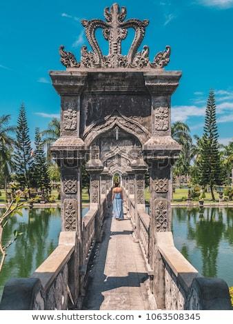 Young woman in dress in Water Palace Soekasada Taman Ujung Ruins on Bali Island in Indonesia. Amazin Stock photo © galitskaya
