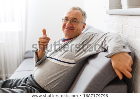 Front view of thoughtful senior Caucasian  male patient sitting on bed at retirement home.  Stock photo © wavebreak_media