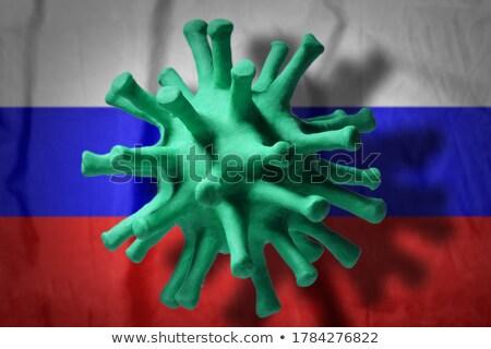 Model of Coronavirus on the background of Russian flag. Stock photo © artjazz