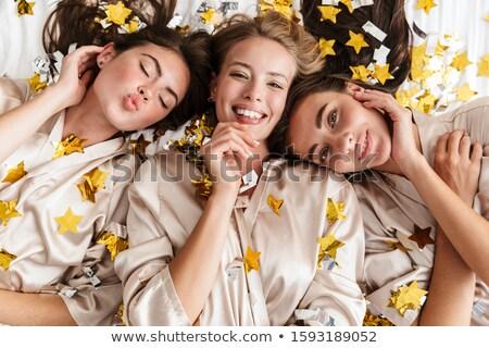 Mujer cama casa confeti imagen Foto stock © deandrobot