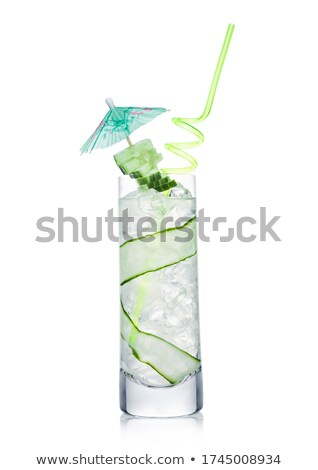 Fresh cold cucumber water in highball glass with ice cubes and cucumber slices on white. Healthy and Stock photo © DenisMArt