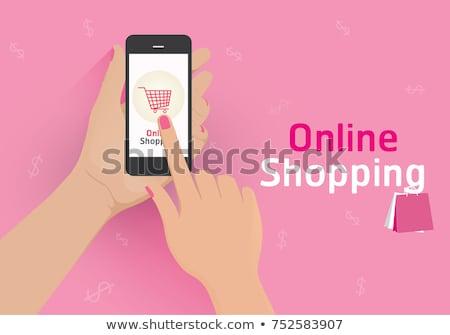 smartphone hand with banknote online shopping Stock photo © yupiramos