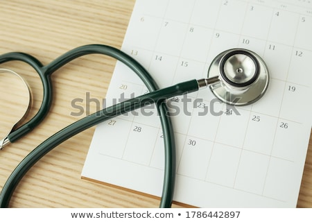 Zdjęcia stock: A Stethoscope On The Calendar Concepts Of Medical Appointment
