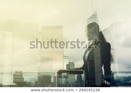 Victorious business woman. Stock photo © lithian