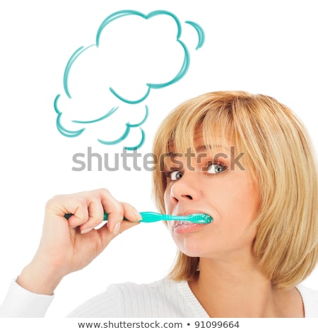 Detail portrait of a happy mature woman brushing her teeth Stock photo © HASLOO