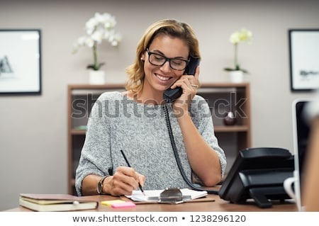 Woman taking a phone call stock photo © photography33