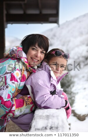 Little girl and mother at their ski cottage Stock photo © photography33