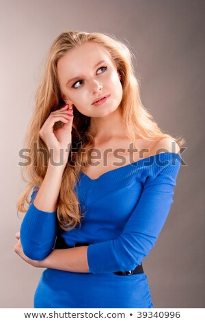 blond woman touching ears stock photo © photography33
