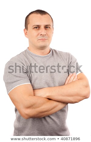 close up of sporty man with muscular arms crossed stock photo © dash