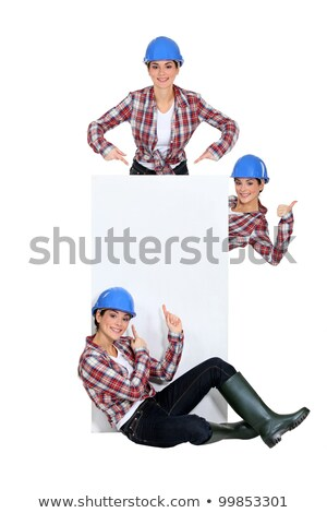 Tradeswoman pointing to a blank sign Stock photo © photography33