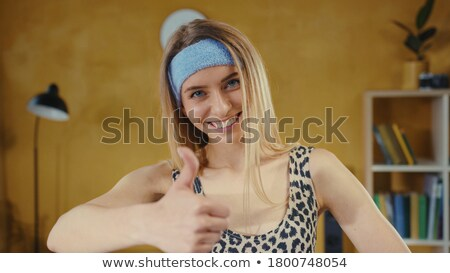 very happy fitness woman showing thumb up stock photo © Rob_Stark