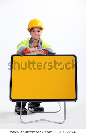 little child dressed in road man is leaning against a yellow road sign panel Stock photo © photography33