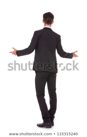 back view of a business man welcoming you stock photo © feedough
