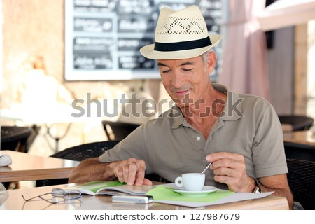 senior gentleman enjoying free time in cafe Stock photo © photography33