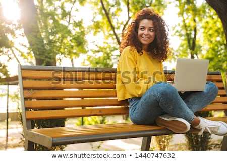 portrait redhead girl at outdoor with laptop autumn stock photo © massonforstock