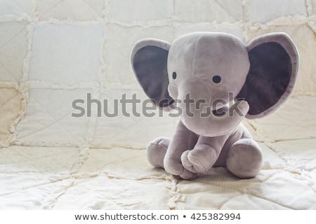 Játék elefánt mosolyog izolált fehér kéz Stock fotó © vadimmmus