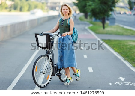Stock photo: Happy young blonde in denim skirt