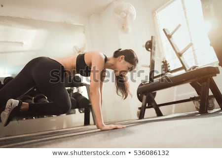 Attractive Asian woman working out with weights stock photo © stryjek