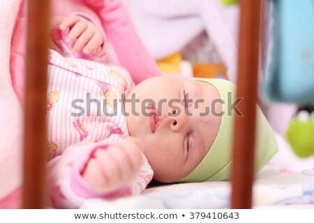 Retrato pacífico bebê adormecido berço casa Foto stock © wavebreak_media
