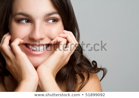 Grin of a gorgeous young laughing woman Stock photo © stockyimages