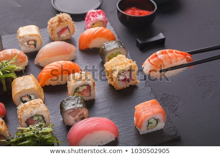 one piece of maki sushi in chopsticks stock photo © frank11