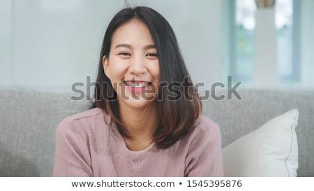 közelkép · portré · ázsiai · nő · nő · mosolyog · visel - stock fotó © luminastock