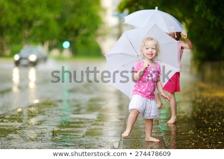 Two little girls dancing in the city Stock photo © lunamarina