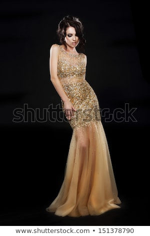 Stylishness. Well-dressed Young Woman in Long Golden Dress Stock photo © gromovataya