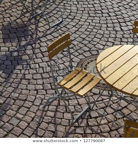 Outdoor German cafe seating with round tables and wooden   chair Stock photo © meinzahn