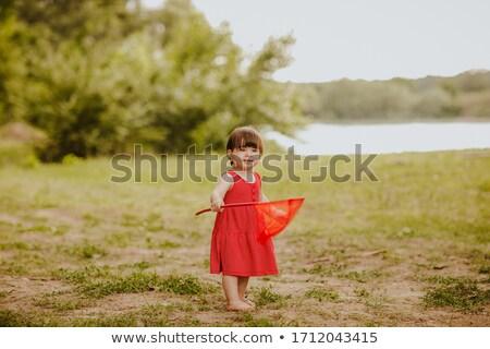 lány · szárnyak · rövid · vörös · ruha · nő · arc - stock fotó © Glenofobiya